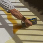 SandRich Adhesive being applied