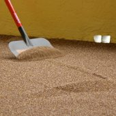 Excess sand being removed once dry